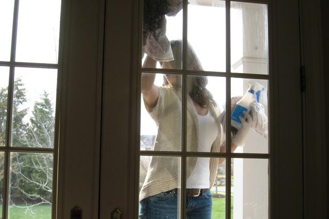 Angela cleaning window